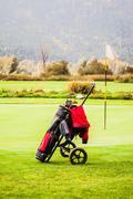 Golf bag near a hole - stock photo