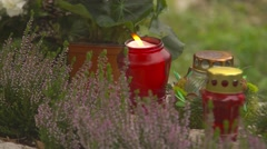 Burning candle and flowers on the tombstones 4K Stock Footage