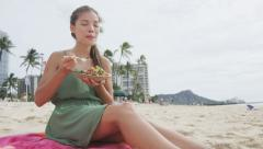 Woman Eating Traditional Hawaii Dish On Beach – Healthy Food Lifestyle - stock footage