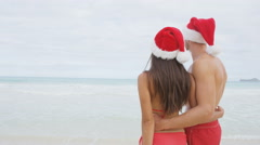 Beach Christmas couple in love on travel holidays winter getaway vacation Stock Footage