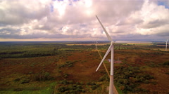Large white windmills on the field Stock Footage