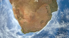 Night to day - rotating Earth. Zoom in on South Africa outlined - stock footage