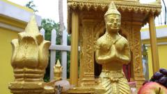 Close up of local spirit house in Southeast Asia; camera starts on gold figur Stock Footage