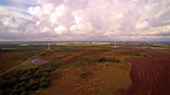 Top view of the large brown field with the windmills Stock Footage