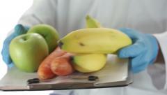 Doctor Hands Vegetables to Patient - stock footage
