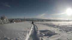 Little skier boy walks on the deep snow Stock Footage