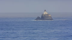 View of the lighthouse with Ecola State Park Stock Footage