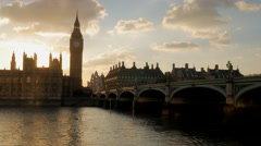 Bus crossing Westminster Bridge at sunset Stock Footage
