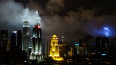 Time lapse of clouds moving on top of the Petronas Twin Towers Stock Footage