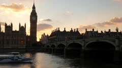 Sunsets behind Parliament as boat passes. Stock Footage