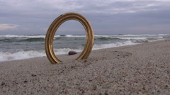 Golden empty frame on beach Stock Footage