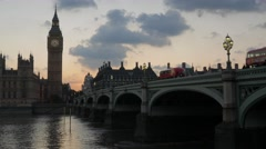 Bus crosses Westminster Bridge at sunset - stock footage