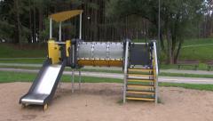 Children playground equipment in pine park Stock Footage