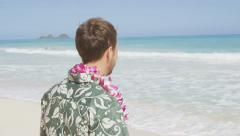 Man On Hawaiian Beach During Vacation Wearing Flower Lei on Travel Holidays Stock Footage