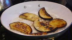 Fried Eggplant Being Cooked in White Frying Pan, 4K Stock Footage