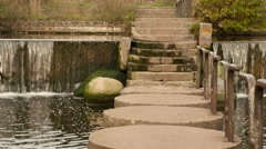Concrete bridge in the park. Autumn daytime. Smooth dolly shot. Stock Footage