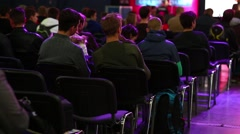 People sit at a concert - stock footage