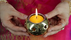 Deepak candle in the hands of Indian women - stock footage