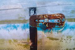 Old door lock on aircraft body. - stock photo