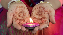 Deepak candle in the hands of Indian women Stock Footage