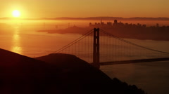 Aerial sunrise view Golden Gate Bridge San Francisco city Pacific America - stock footage