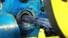 Pipe processing at the factory. Industrial machinery for pipes manufacturing. Stock Footage