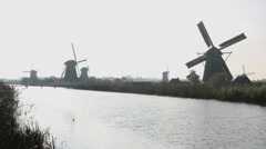 Autumn morning on the canal in Netherlands Dutch windmills at Unesco Kinderdijk Stock Footage