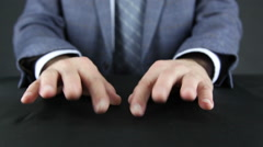 Man in a suit tapping his fingers on the table Stock Footage