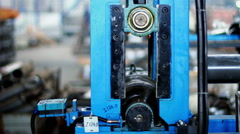 Manufacturing of blanks on the machine. Metal pipes manufacturing Stock Footage