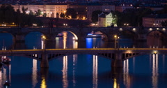 Boats floating at night on Vltava River, Prague Time Lapse Stock Footage