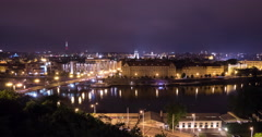 Čechův most and Vltava River at night in Prague Time Lapse Stock Footage