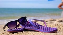 Tropical Vacation on Beach with Flip-Flops and Sunglasses Stock Footage