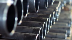 Pipes on warehouse. Stack of steel tubes. Closeup of stack of metal pipes Stock Footage