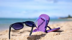 Summer Vacation - Flipflops on Sandy Ocean Beach Stock Footage