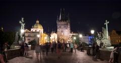 People walking near the Old Town Bridge Tower in Prague Time Lapse Stock Footage