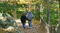 Older Couple Walking on Forest Trail in Autumn, 4K - stock footage