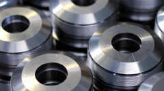 Closeup pattern of shiny circular precision metal parts Stock Footage