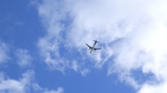 Flying Airplane in Blue Sky Stock Footage