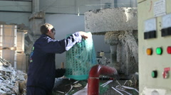 Worker dumping paper in recycling factory Stock Footage