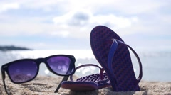 Slippers and Sunglasses on Beach on Vacation - stock footage