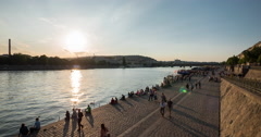People walking on the waterfront at sunset in Prague Time Lapse - stock footage
