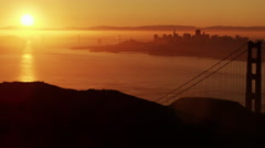 Aerial sunrise view Golden Gate Bridge San Francisco city America Stock Footage