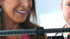 Exam: Woman Excited To See Weight Loss On Scale Stock Footage