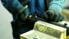 Professional master assembles the billet at factory. Manual labor in a factory - stock footage