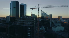 Aerial Shot of Construction of Office Building in Business District - stock footage