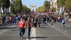 """People walking on Champs Elysees during the """"Day without cars"""" event in Paris - stock footage"""