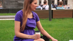 Pregnant women drinking coffe and eating on the street. Stock Footage