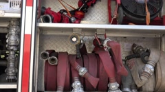 Stock Video Footage of Fire hoses, oxygen cylinders and other equipment in firefighter truck. 4K