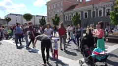 Happy people enjoy bubble blow in main square of Vilnius. 4K Stock Footage