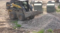 Special tractor load rubble into scoop near sidewalk tiles stack. 4K Stock Footage
